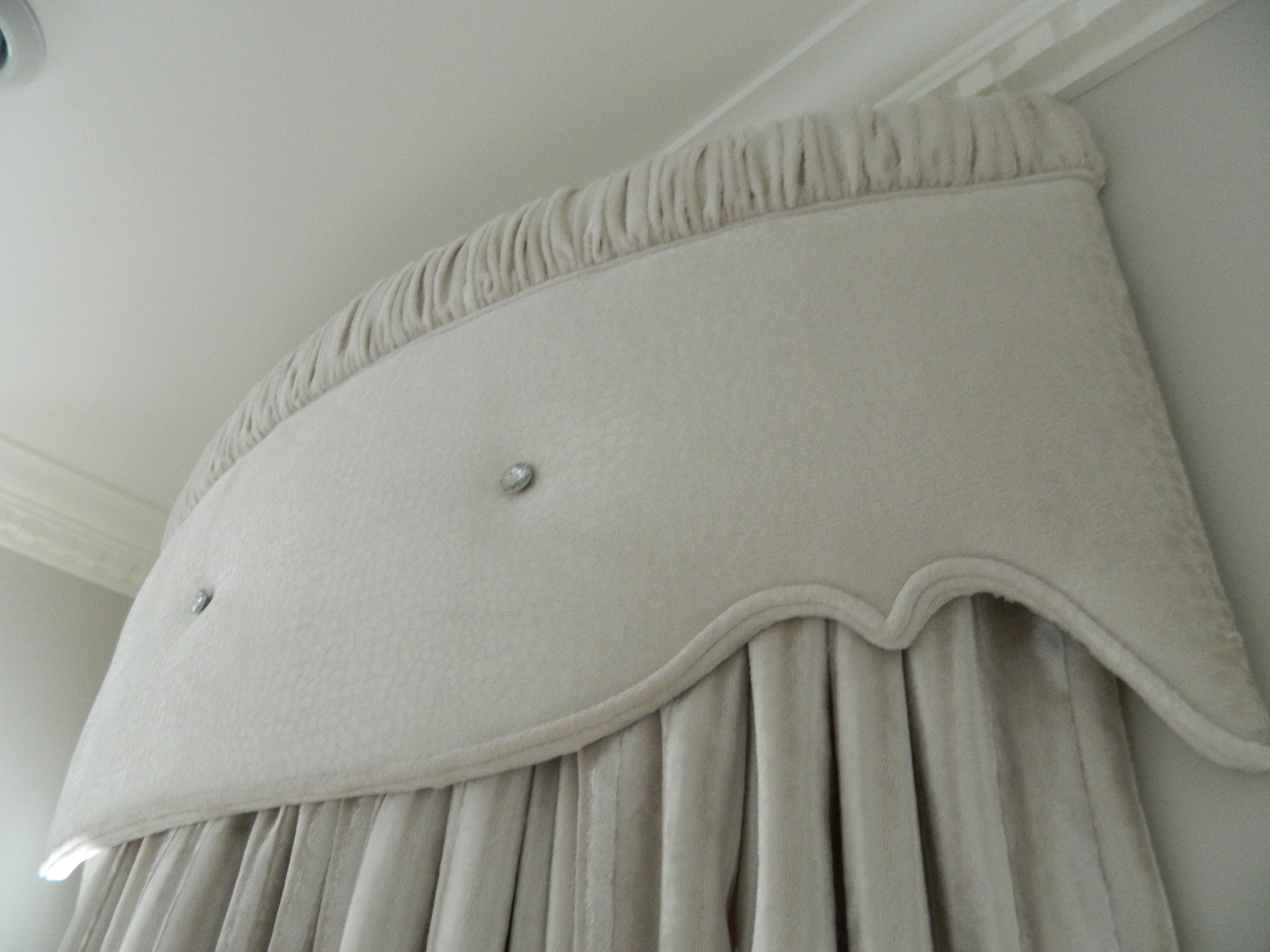 Beautiful curved pelmets with jewel detail.
