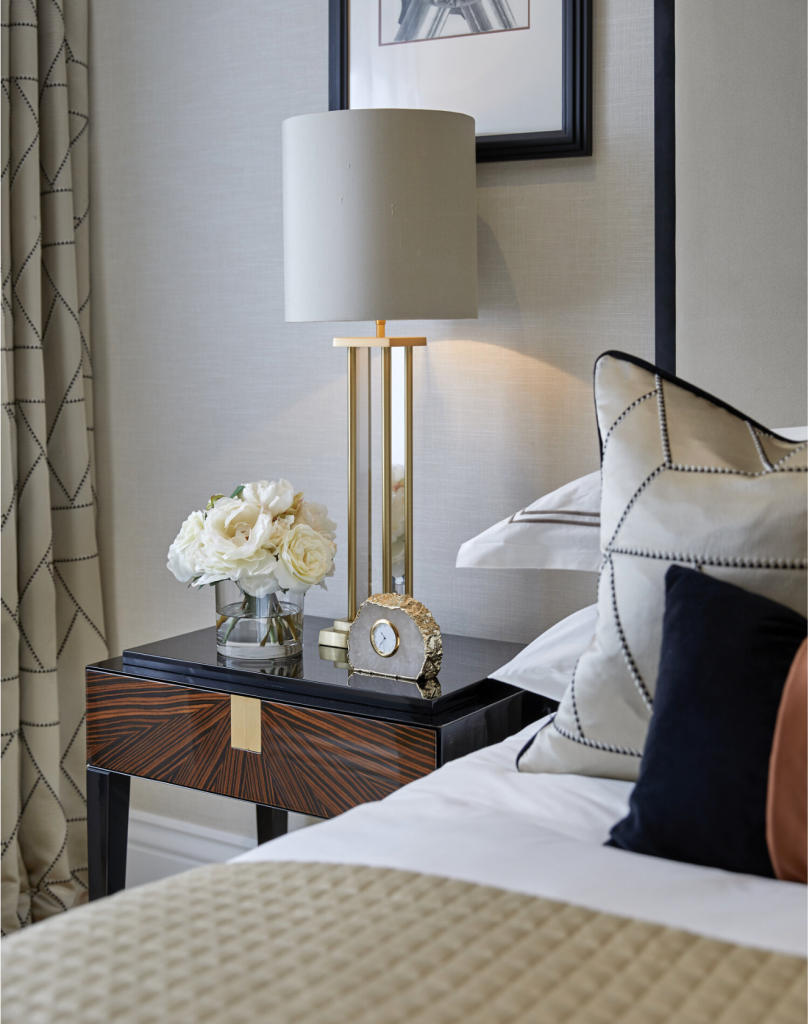 bedside table and white bedlinen